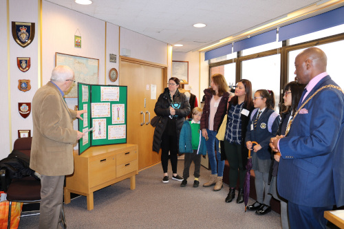 Sittingbourne in Bloom's Tony Thorley explains the designs to schoolchildren